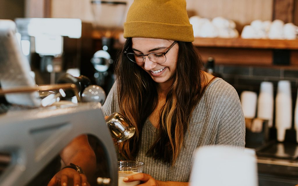 how to be happy with yourself a barista making happy coffee bringing happiness to others